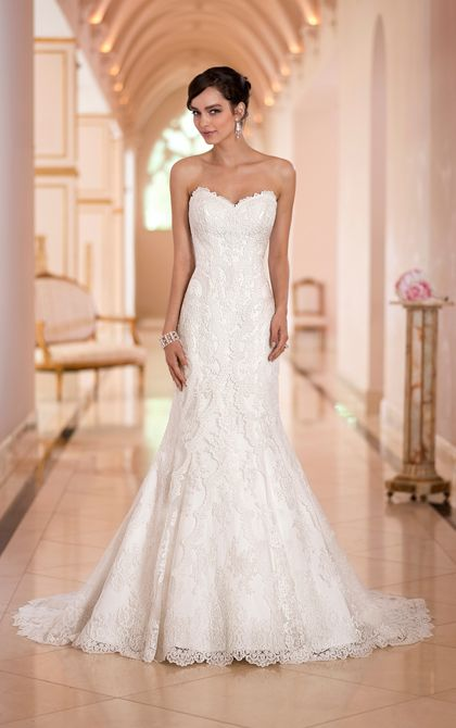 This Lace over Dolce Satin lace wedding dress from the Stella York collection features a lovely sweetheart neckline and trumpet silhouette that is both slimming and sexy. You'll love how this vintage lace wedding dress takes an eye-turning shape with a close-fitting bodice that hugs the body down through the hips and then gracefully flares out to the hem.