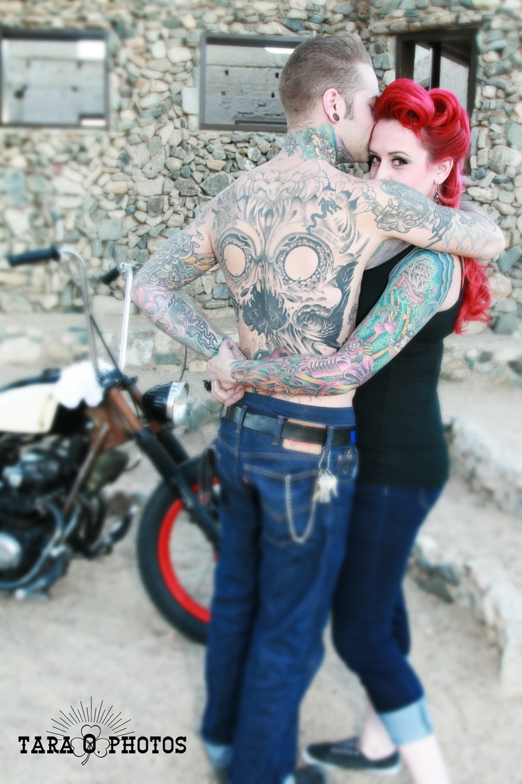 Like the look over the shoulder tattooed engagement photo