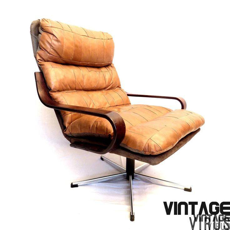 Prachtig ontworpen Deense design fauteuil met dik patchwork cognac bruin leer.