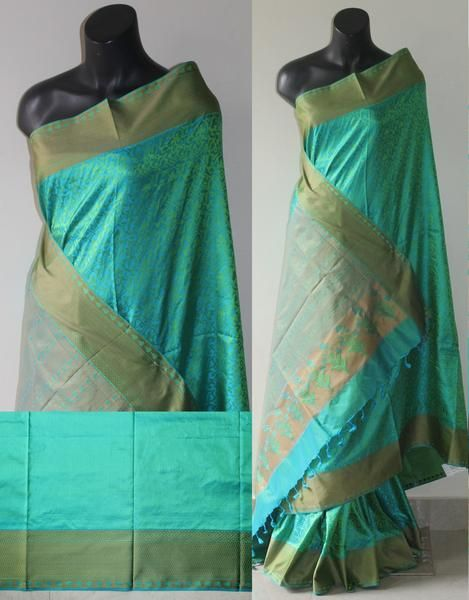 Green and blue double shaded banaras soft silk saree,fine zari weave border with pallu. This exceptionally well designed silk saree features rich borders that a