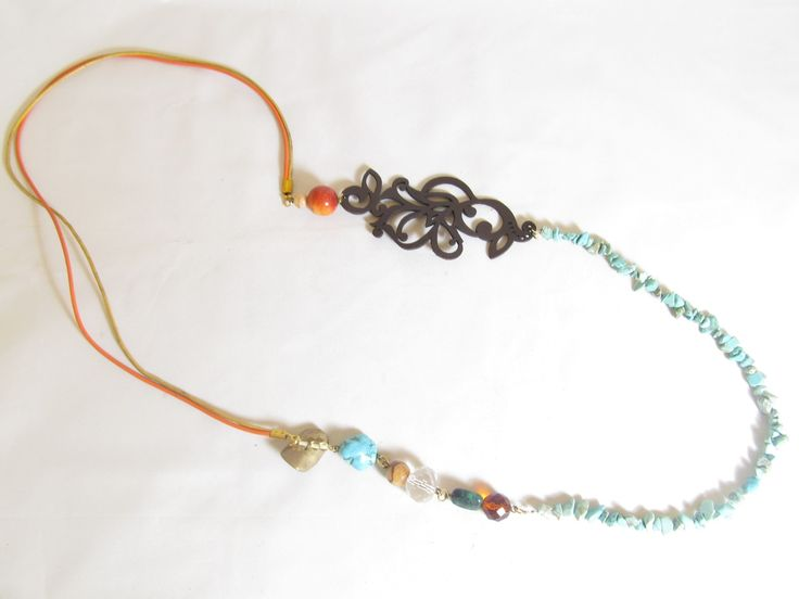 Handmade long necklace with brown leather filigree (1 pc)  Made with brown leather filigree, leather cords, brass metal with white freshwater pearl, semiprecious stones and glass beads.