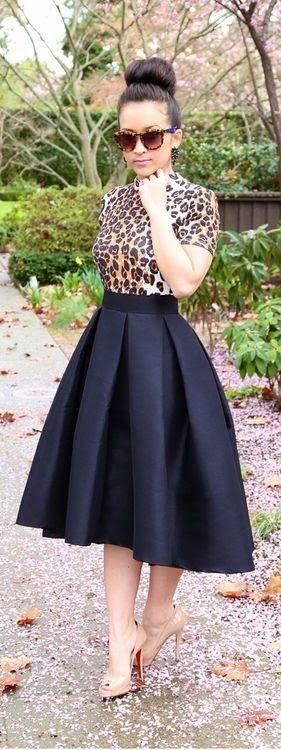 Leopard print top, full black midi skirt, nude heels, high bun hairstyle