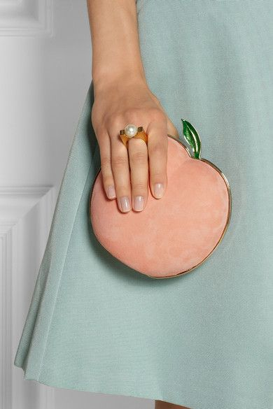 Clutches are great for sporting unique designs like this peach suede clutch