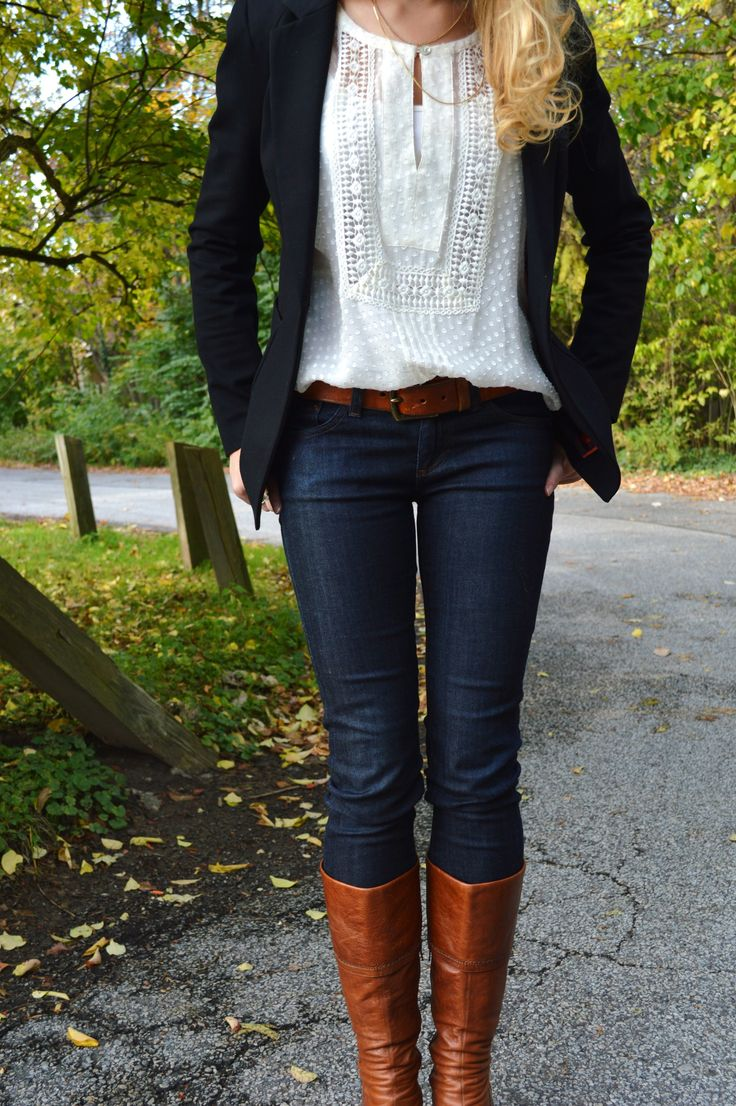 Navy Blazer, white crochet blouse, jeans tucked into boots.  Cute!
