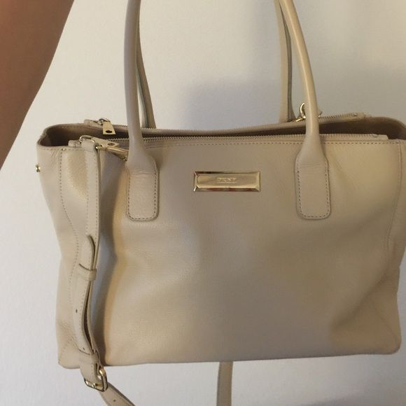 DKNY leather nude purse In good condition, few minor signs of wear. It's priced to sell DKNY Bags Satchels