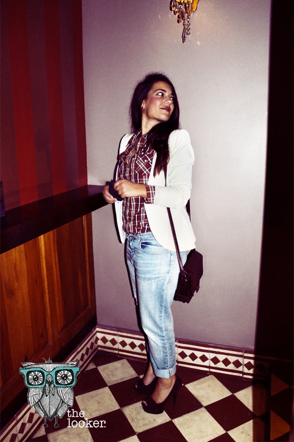 Proof that a check shirt suits any occasion. The white blazer tones down the multicolor canvas along with the bf reversed light blue jeans A pair of purple pumps and a bag to match take the look to a higher posh level.  http://the-looker.blogspot.com/
