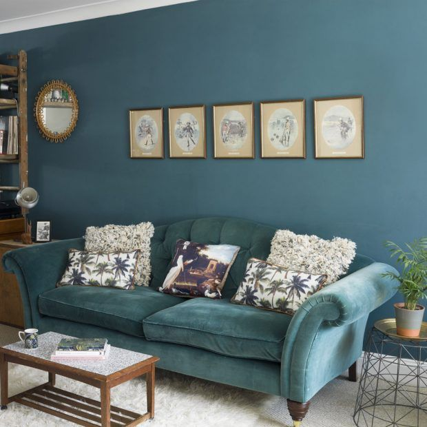 Blue living room with vintage furnishings and shaggy cushions