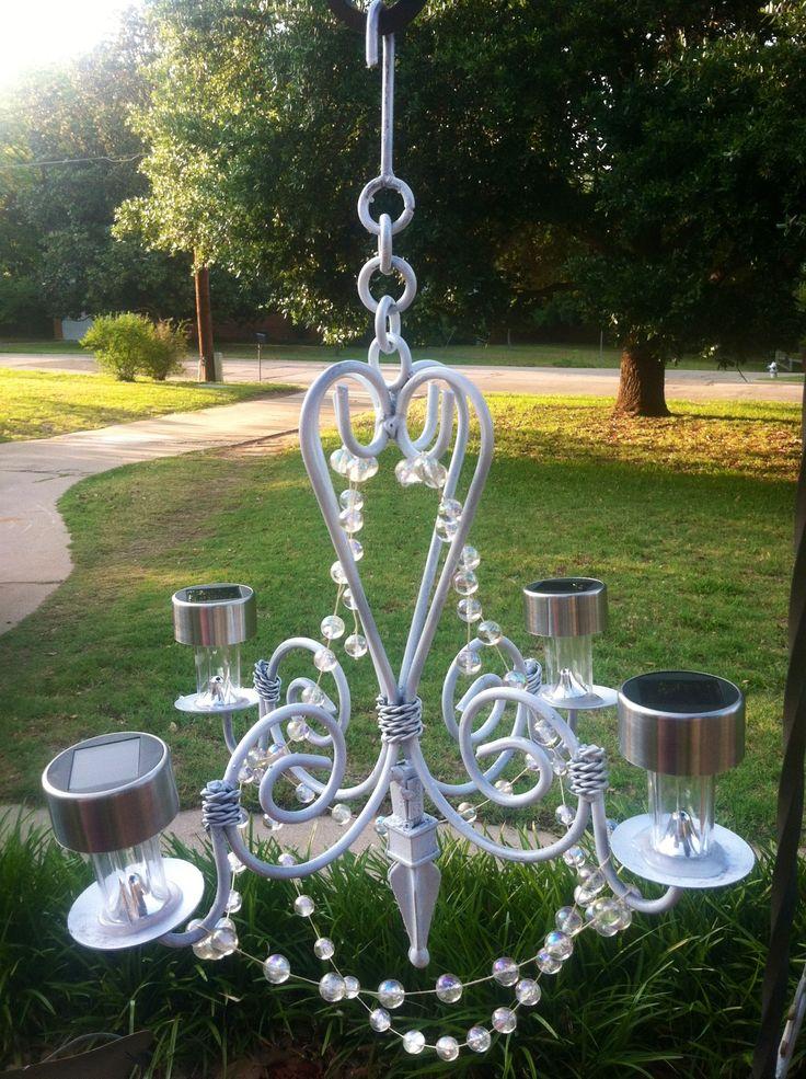 My homemade outdoor glitzy solar chandelier. Cut off stems of dollar store solar lights.  Hot glue to vintage chandelier, add beads....instant garden glam!!!