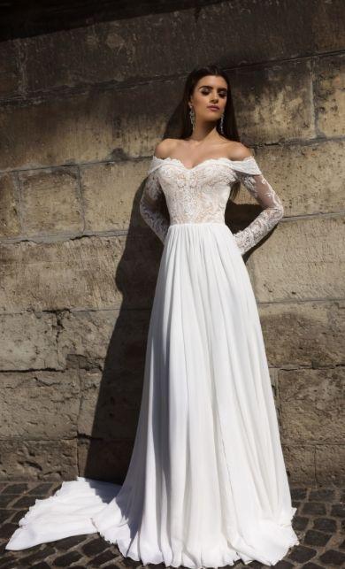 Romantic off-the-shoulder wedding dress with effortless silk chiffon skirt; Featured Dress: TM Crystal Design