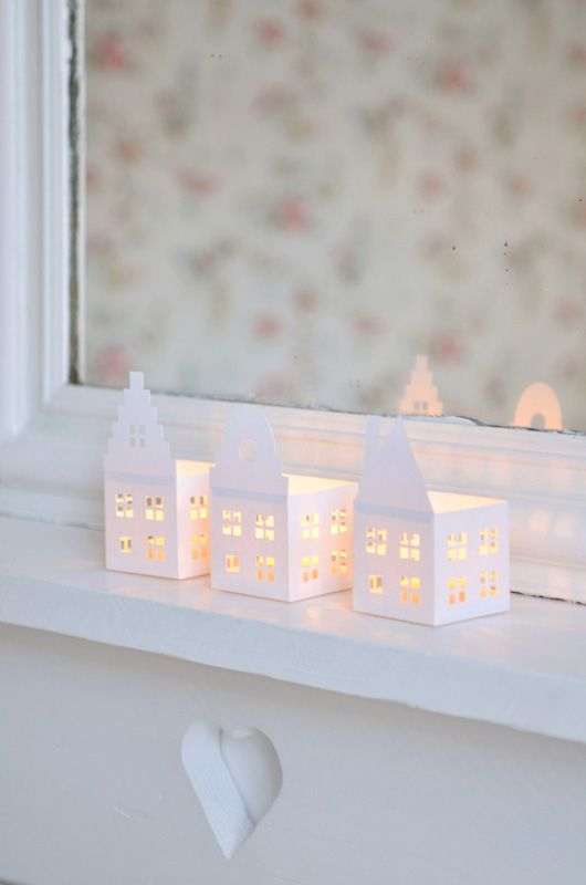 cute paper houses--maybe to replace those Christmas lights in my windows that I will so miss (but I wouldn't risk the tea lights unless battery operated)
