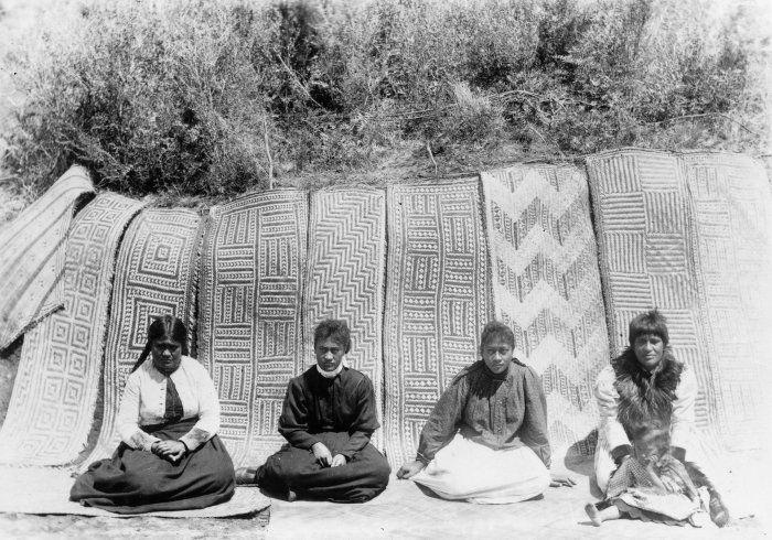 Te Arawa women with mats woven for Rauru meeting house at Whakarewarewa, Rotorua