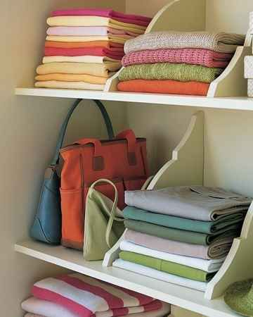 Hang your shelves upside down so that the brackets automatically create built-in compartments.