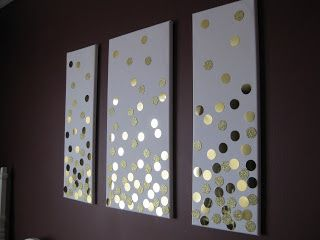 artist canvas, 2 in. hole punch, gold card stock, sparkly paper, spray adhesive. That's it!