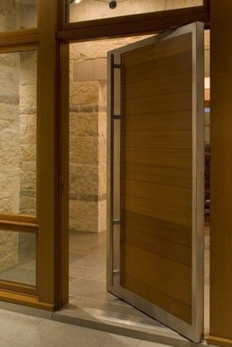 """by Furman + Keil Architects """"warmth of the wood and stone contrast. love the door"""""""