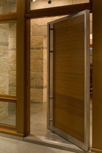Fricken love an oversized pivot door! Yes, please! modern entry by Furman