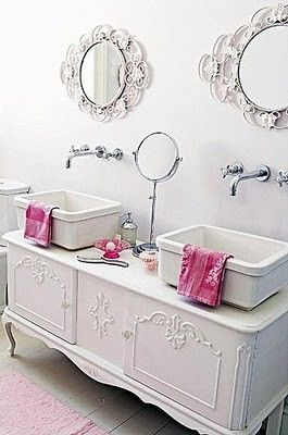 Oh, my! I'm not even kidding! I love this! So girly & glam! I don't know what the tub & shower look like but in my dreams the tub is porcelain claw foot with a separate subway tiled rainfall shower Source: French White Dash of Pink-Lovely French white vanity, and double sink for the bathroom. A dash of pink is added with the hand towels giving an ultra feminine atmosphere. The beauty of completely white spaces is that you can change the entire feel by accessorizing with different colors.