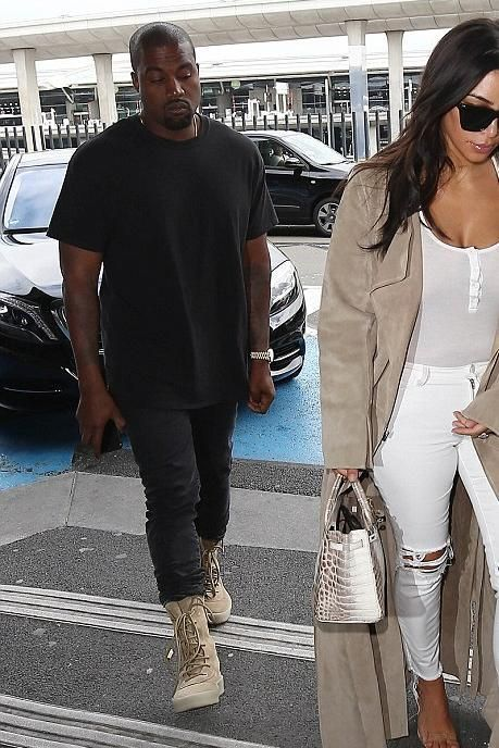 aa1b817436a Kanye West wearing Acne Studios Ace Used Cash Slim-Fit Jeans and Yeezy  Season 2 Taupe Crepe Boots