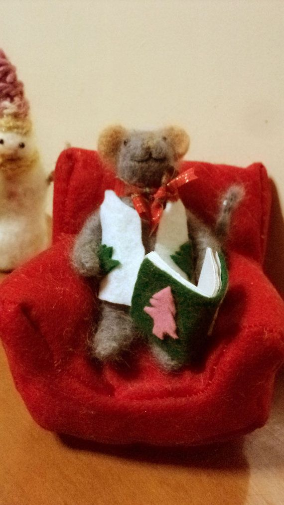 needle felted Christmas mouse sitting in an armchair by Kunuli
