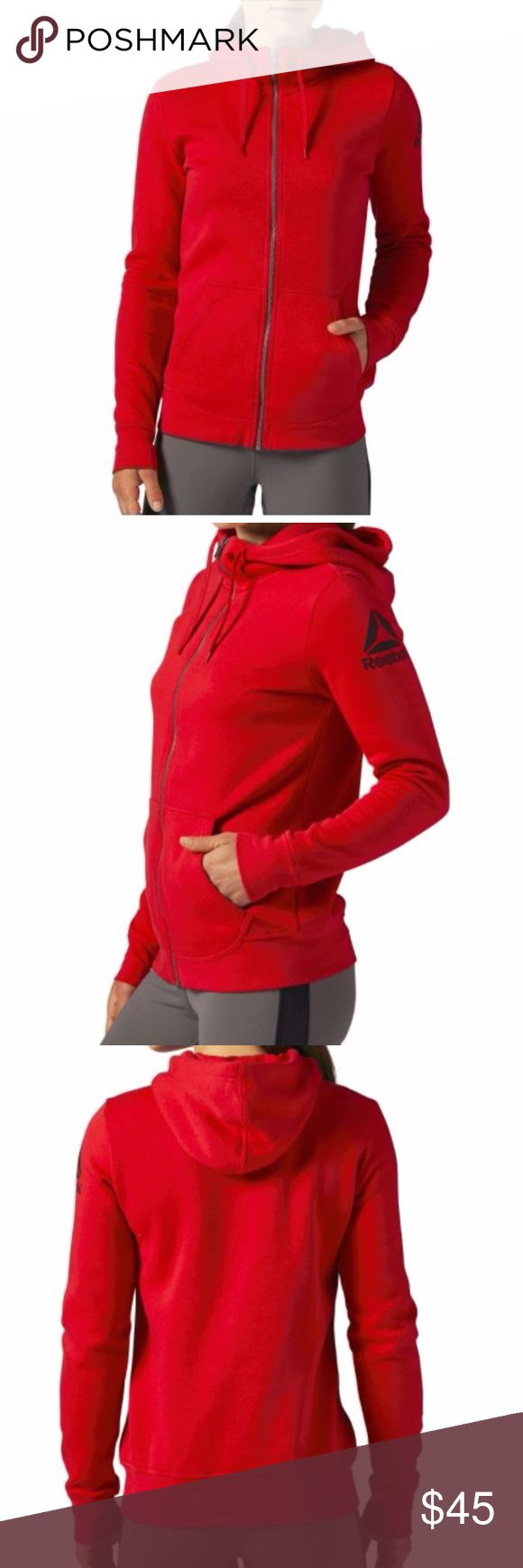 BNWT Reebok Women's Full Zip Jacket w/ Hood Brand New w/ Tag Reebok Women's  FLEECE HOODIE WITH KANGAROO POCKETS Color: Red Fabric: 70% Cotton / 30% Polyester, fleece fabric for comfort and warmth Fit: Slim - wears close to the body for a sleek, sophisticated silhouette Best for: Casual wear, layering, cool weather Full-length zipper for easy layering Two-panel hood with a drawcord for an adjustable fit Kangaroo pocket for storage and warming hands Ribbing at the hem and cuffs creates a snug…