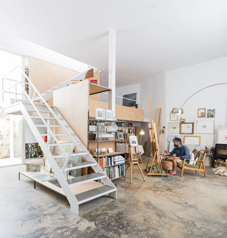positioned at the highest point of the village, the white-walled contemporary dwelling capitalizes on natural light to offer the painter a comfortable place to work and live.