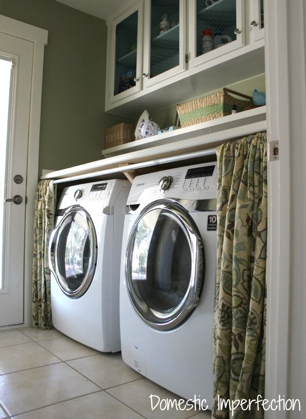 front-loading-washer-and-dryer-with-counter-and-curtains
