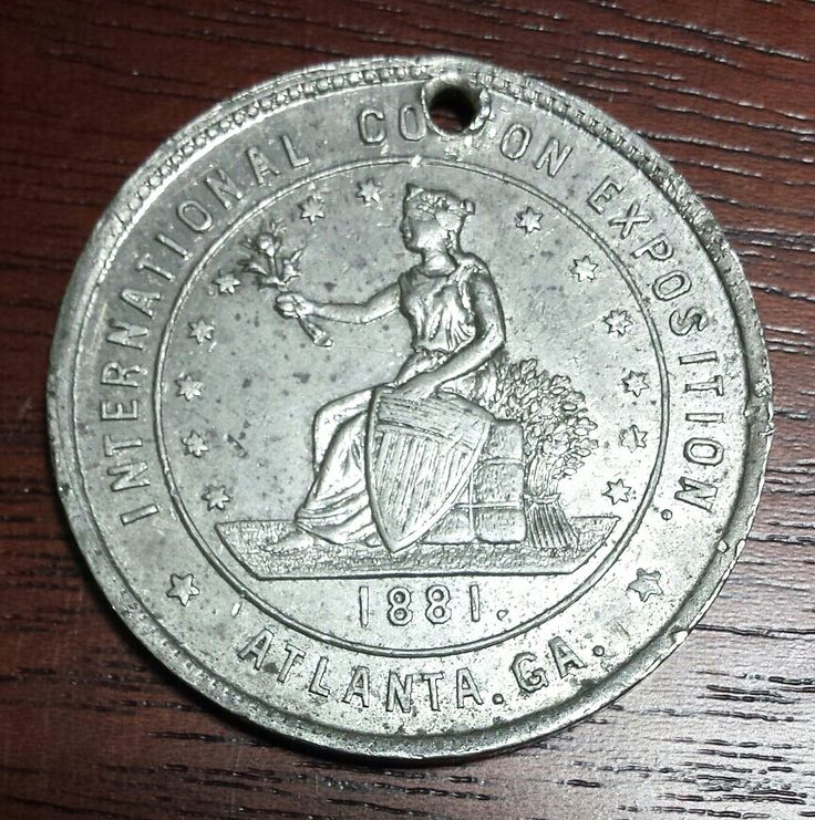 Medal or badge issued for the 1881 International Cotton Exposition held in Atlanta. From the J. Fred Rodriguez Atlanta Collection.