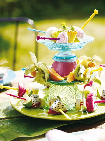 summer garden party exotic fruits spikes tiered stand bowls #gardenweddings #weddingmenu #tablecenterpieces