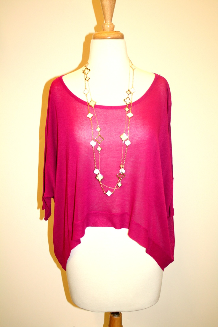 Another one of our flowy sweaters, worn with our great layered gold necklaces!
