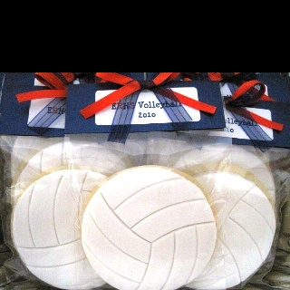 Volleyball cookies @Maria Canavello Mrasek Canavello Mrasek E I am thinking we could do white chocolate covered oreos.