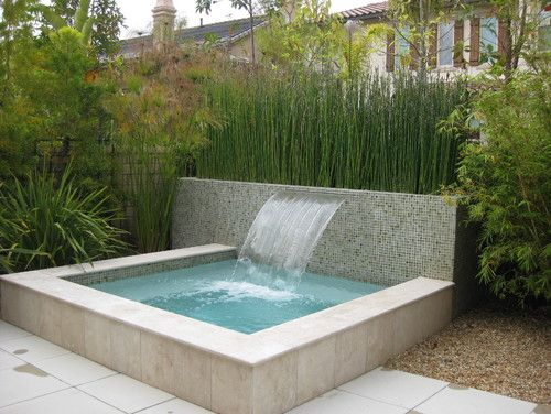 Back of pool wall idea: glass tiles to match the water line tile inside pool