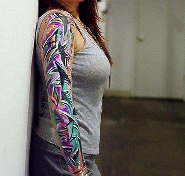 16 Feminine Sleeve Tattoos for Women - http://slodive.com/tattoos/18224/