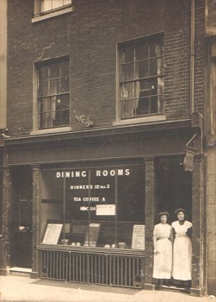 'Dining Rooms' with two waitresses standing in the doorway Brentford High Street Late Victorian.