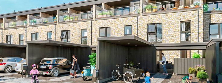Eksklusive rækkehuse i 3 plan med stor tagterrasse på øverste etage - med en flot udsigt. Huset har egen carport med udhus.