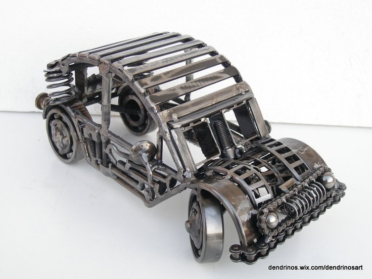 Metal sculpture of a car created by artist Giannis Dendrinos
