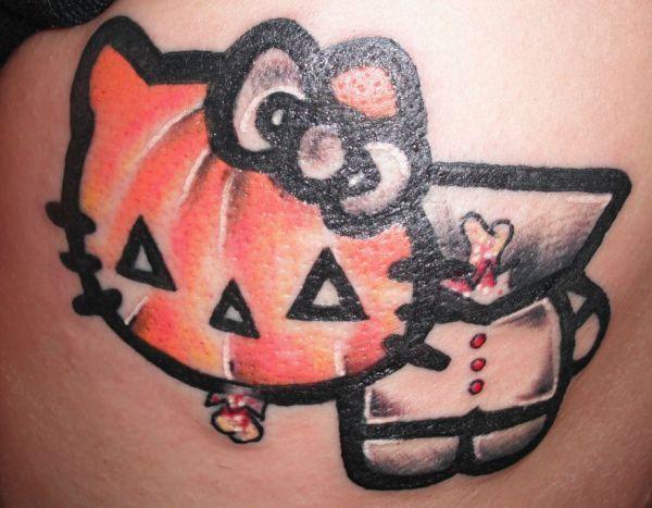 tatouages hello kitty citrouille   15 tatouages Hello Kitty insolites   vendredi 13 The Walking Dead tatouage tatoo squelette spoke photo im...