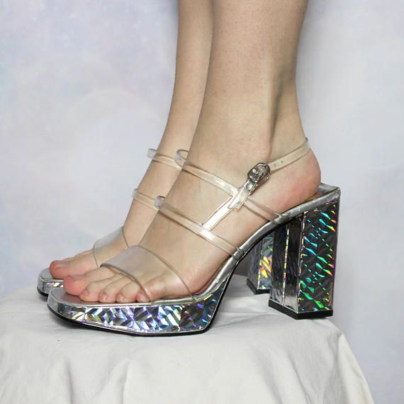 OMG these holographic high heels are EVERYTHING. These are platform sandals with a huge chunky heel and clear jelly straps with a buckle closure. These are perfect for prom, pole dancing, clubbing, Halloween, drag, burlesque, modeling - basically, these are perfect for looking hella
