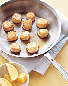 Pan-Seared Scallops with Lemon | Couldn't get any easier than this recipe. Pat scallops dry and season with salt and pepper. Cook in olive oil for ~3 minutes per side on medium-high. Garnish with lemon. DONE.