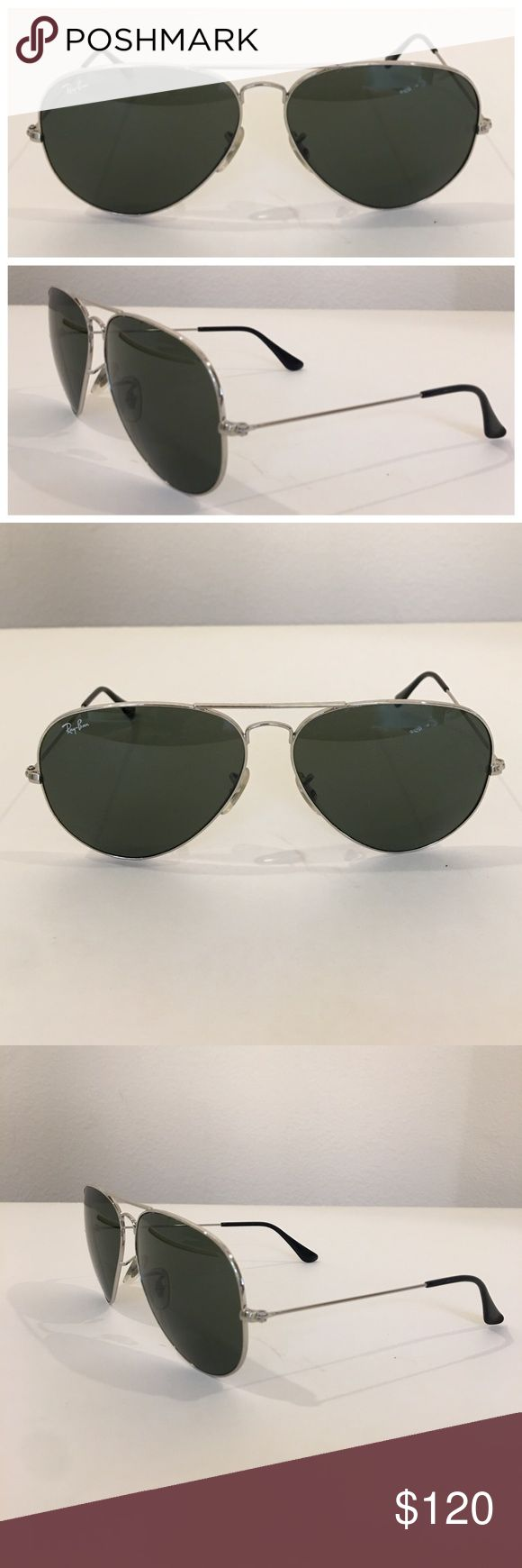 Authentic RAY BAN large aviator sunglasses Authentic RAY BAN silver tone large metal aviator sunglasses, made in Italy, model RB 3025. In preowned condition with very gentle scratches on the lens.  Signature RB etched into lens with serial number etched i