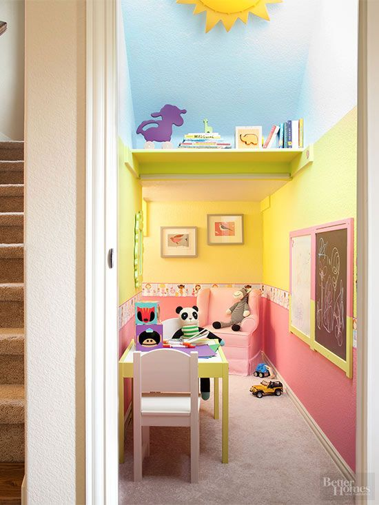 This stairway makes a right turn as it ascends to the second floor, leaving a spacious alcove below. The roomy chamber now enclosed by a pocket door handily houses a playroom that stores kids' toys, furniture, and art gear outside family living areas./