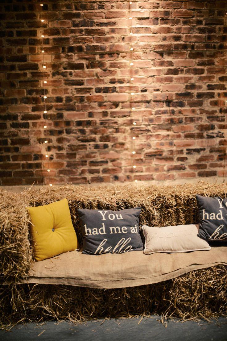 Hay BAle Seating Area with coloured cushion & love quotes | Scottish Wedding | Autumn Wedding | Rustic Wedding | Barn Wedding | Grey & Yellow Colour Scheme | Image by Crofts & Kowalczyk Photography | http://www.rockmywedding.co.uk/jen-bob/