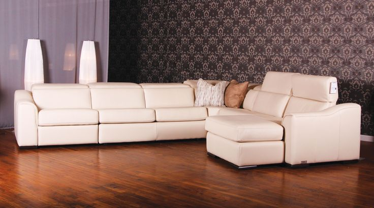 Rodolfo in Panamera cream leather by Jaymar. Retractable head-rest Motorized reclining mechanism. Sectional made in Canada