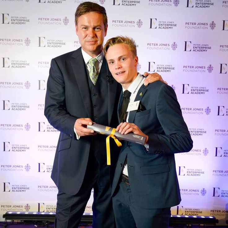 Founder and CEO of Opulent Leather celebrating his success with entrepreneur  Peter Jones