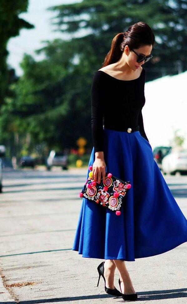 Black wide-neck sweater, long cobalt blue skirt, belt, heels, statement clutch