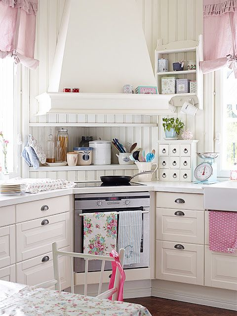 Adorable Kitchen! I would never go in our house, but I do like the idea of the shelf tucked away above the cook top.