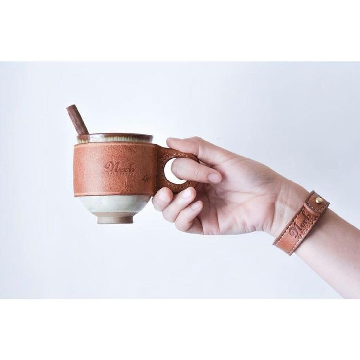 Ceramic cup with leather holder