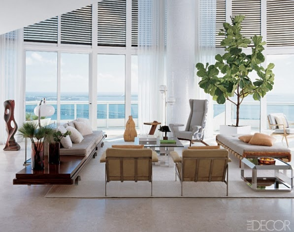 White sheer draperies on tall windows in a modern living room