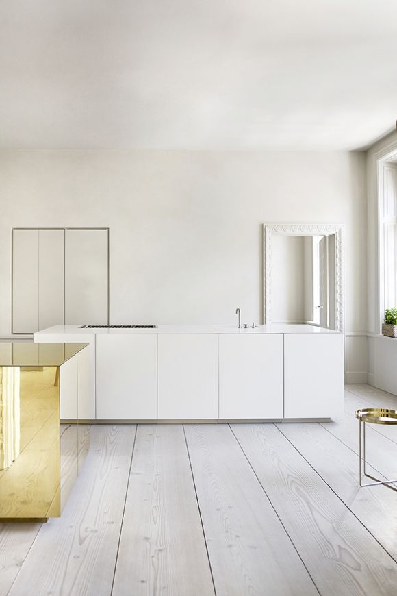 Stockholm home white and yellow gold kitchen
