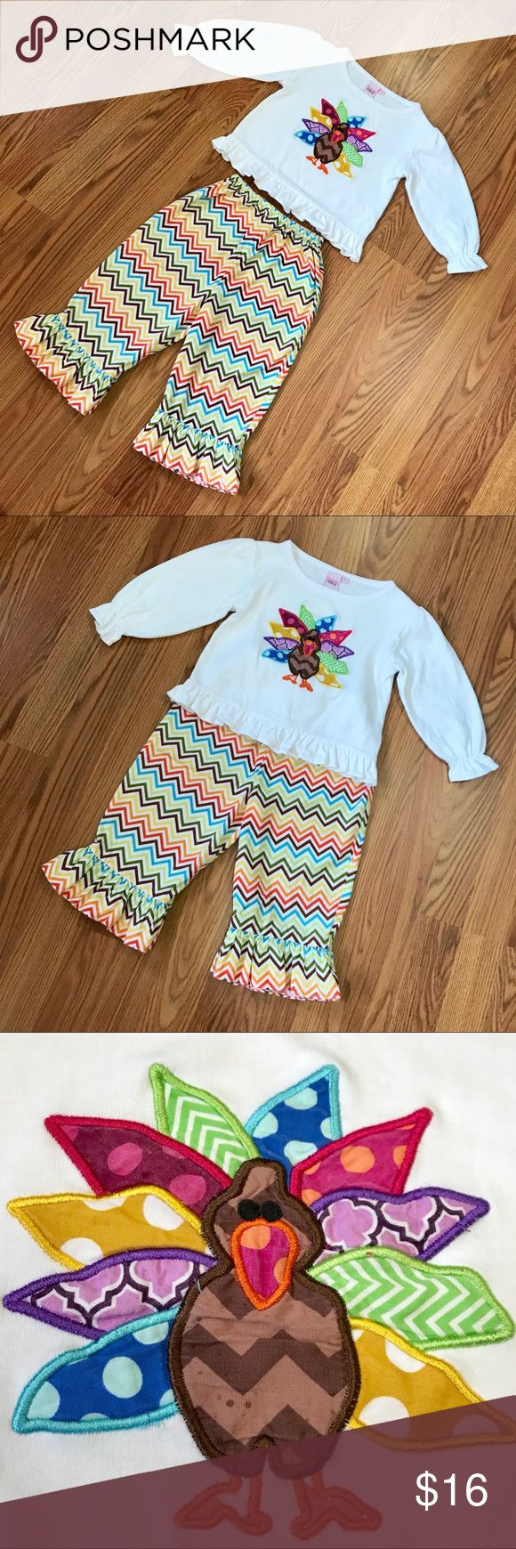 "Boutique Appliqué Turkey Top/Chevron Pants Outfit Top is a size 4T but runs a little small in my opinion, maybe like a 3-4T. Brand of top is Natalie Grant See pics for measurements. Adorable ruffle chevron pants are 3T and inseam length is 11"". Both in great used condition from a smoke/pet free home. Natalie Grant Matching Sets"