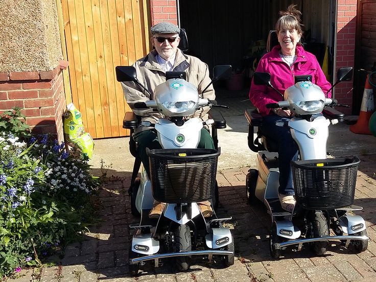 Mr & Mrs Dean staying independent together on a matching pair of Vitess 2 mobility scooters. Book your test drive today