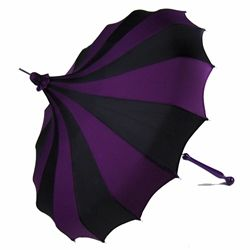 This shape of umbrella always makes me think of The Penguin. And I friggin love it!!!!!!